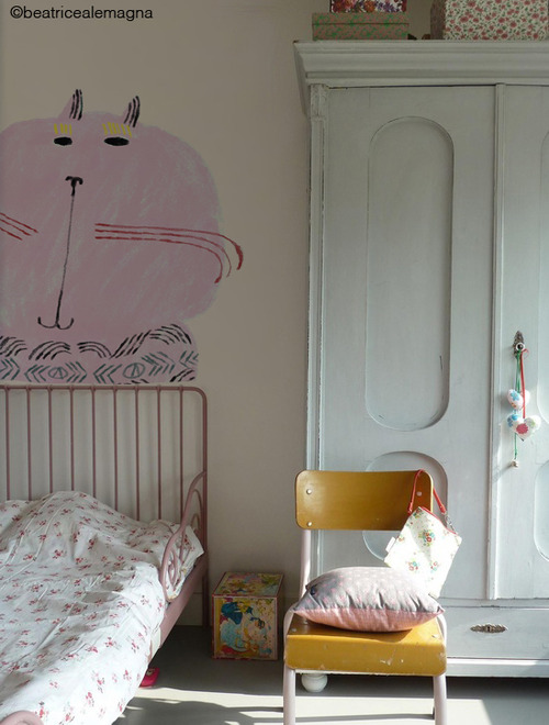 A kid's room with a touch of pink
