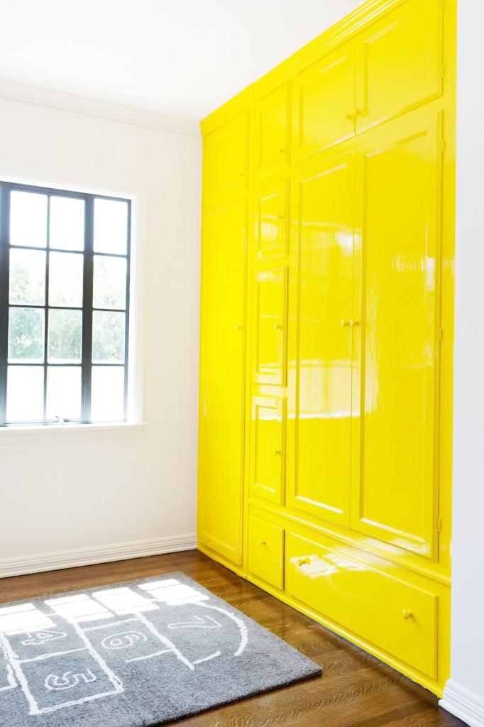 Yellow wardrobe in kids room