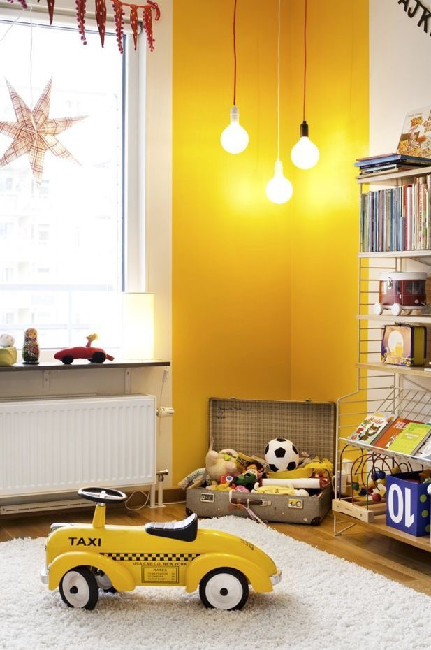 Yellow wall playroom