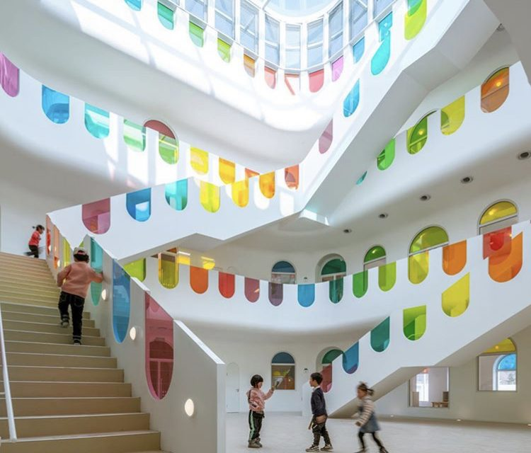 Rainbow preschool designed to inspire creativity.